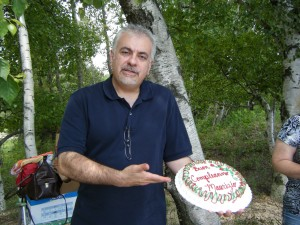 "Dad holding his beautiful cake. Says, ""Buon Compleanno, Maurizio"""